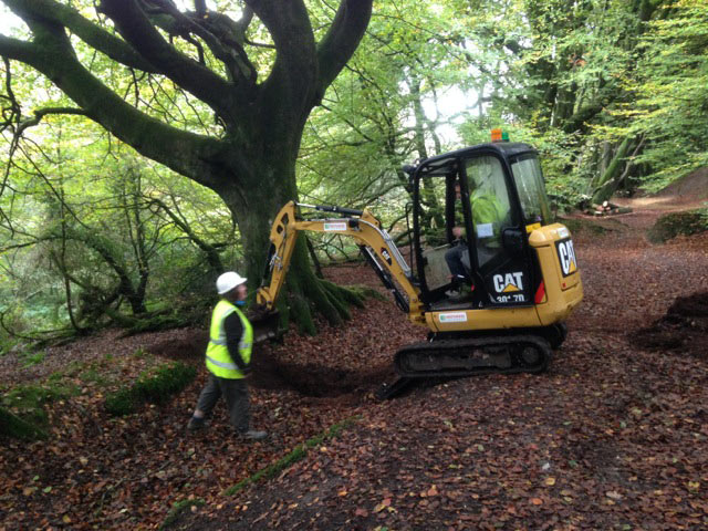 DCC archaeologist working with the digger man sorting the parish boundary ditch out